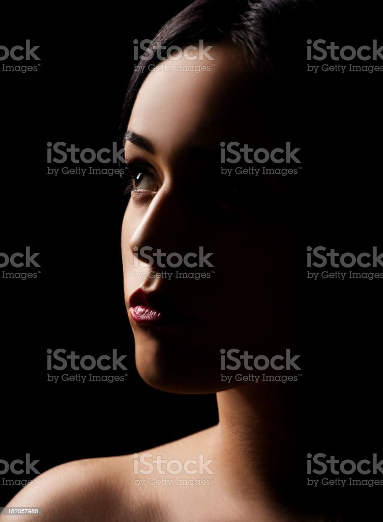 Low key portrait of women stock photo
