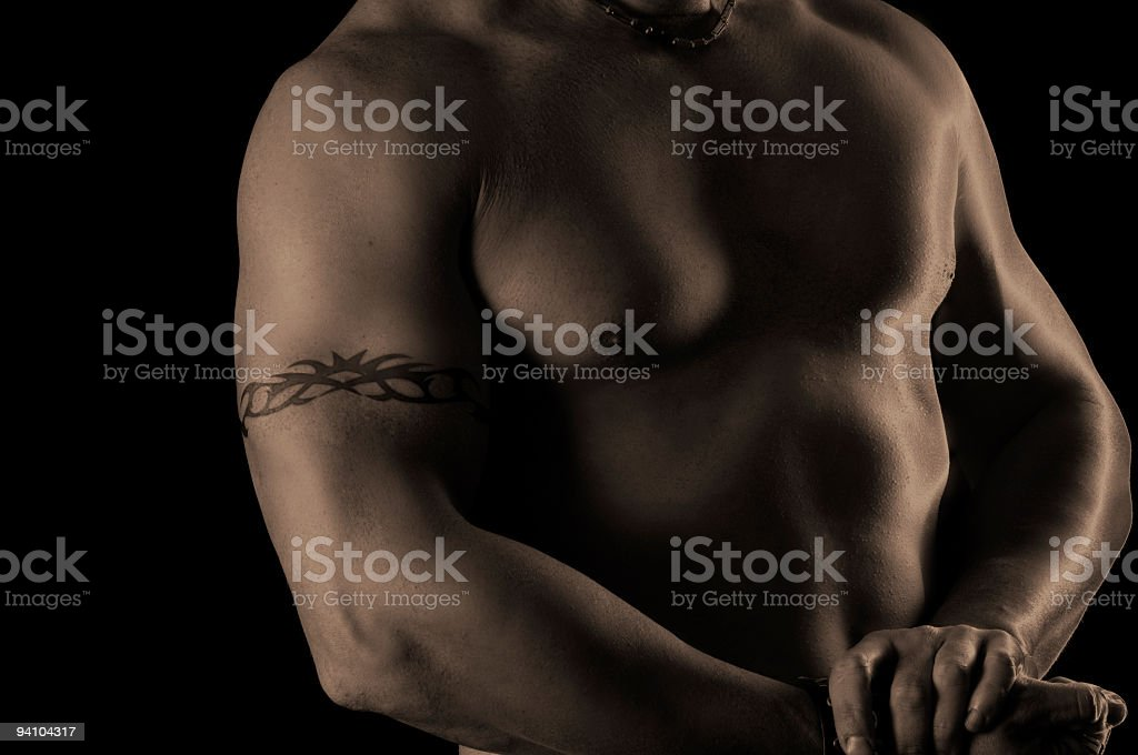 Low key, solarized, image of a man's chest. royalty-free stock photo