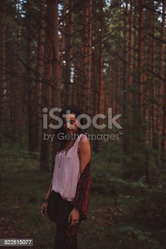 509923232 istock photo Low key vintage portrait of a girl walking in forest 522515077