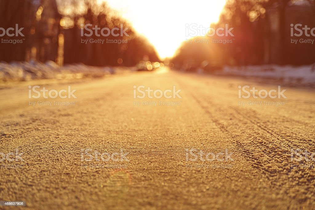 low level photo of empty road in town stock photo
