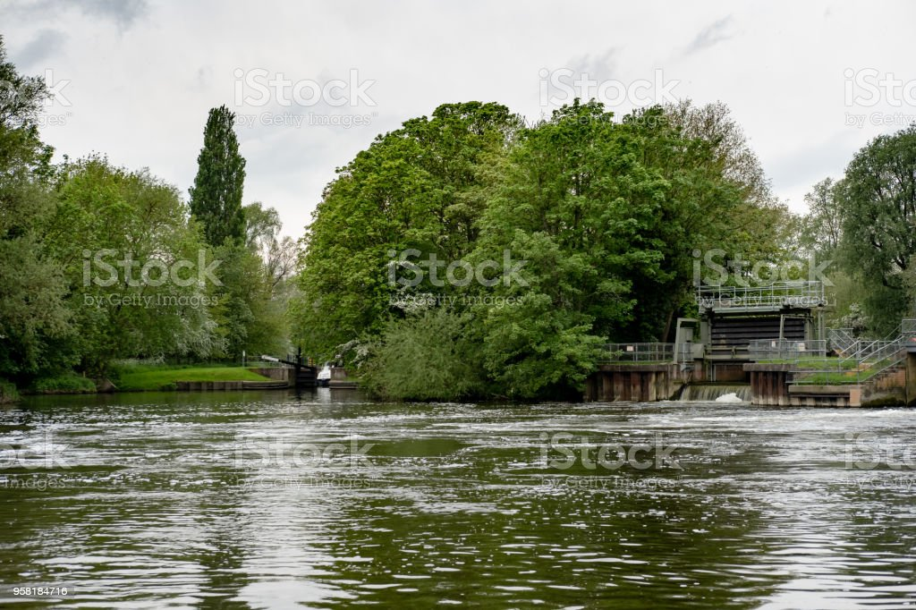 Low level view of a large canal and inland waterway seen in rural England. stock photo