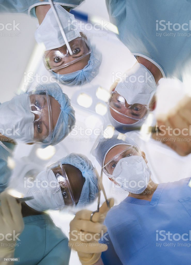 Low level view of surgical team operating stock photo