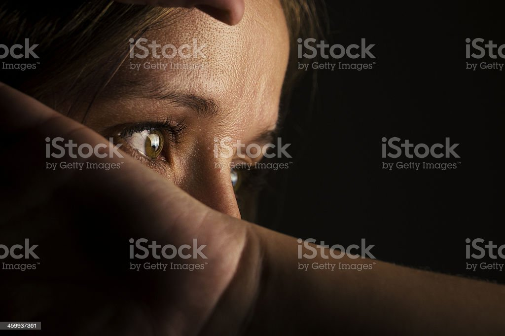 Low light portrait of young woman. royalty-free stock photo