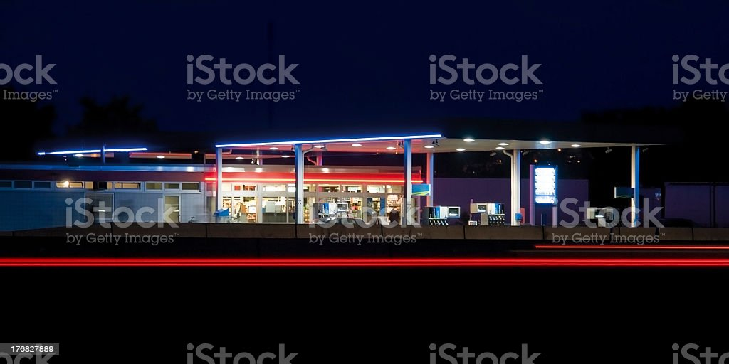 Low light service station caught highlighting blue/red hues royalty-free stock photo