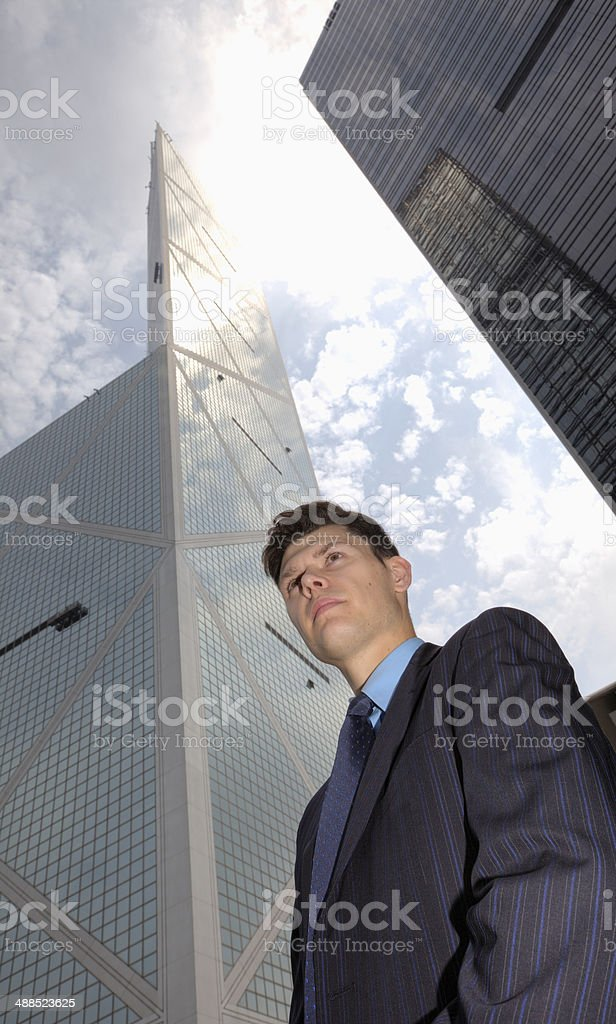 Low perspective of businessman royalty-free stock photo