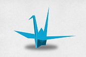 Close-up on a low poly model of a origami crane.