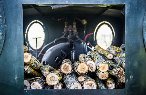 Thin logs prepared to be burned in the steam engine