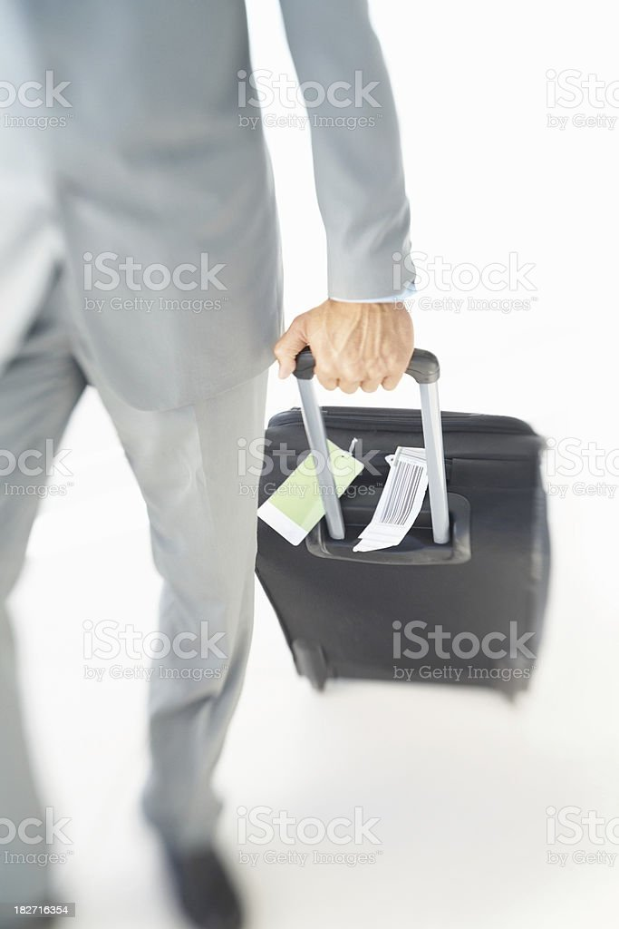 Low section of a business man with his luggage royalty-free stock photo