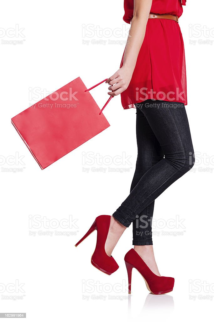 Low section of a woman with her red shopping bag stock photo