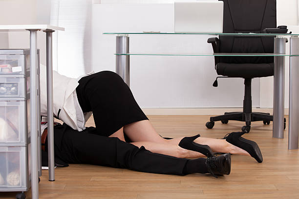 Low Section Of Business Couple Getting Intimate On Floor stock photo
