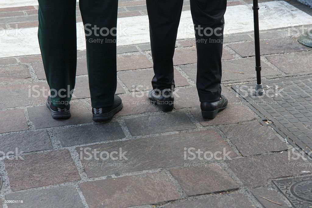 low section of senior couple outdoors stock photo