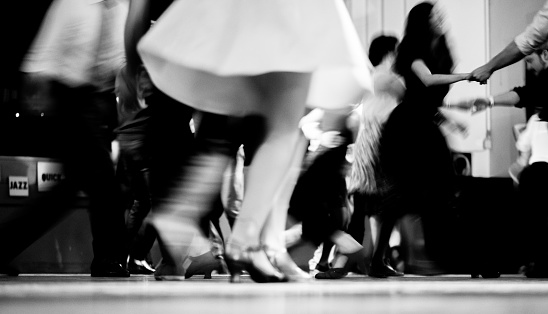 Low section of Vintage style photography people dancing