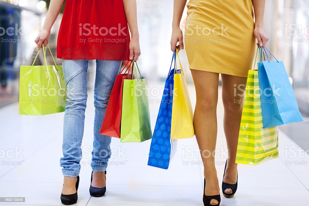 Low section of women carrying shopping bags royalty-free stock photo