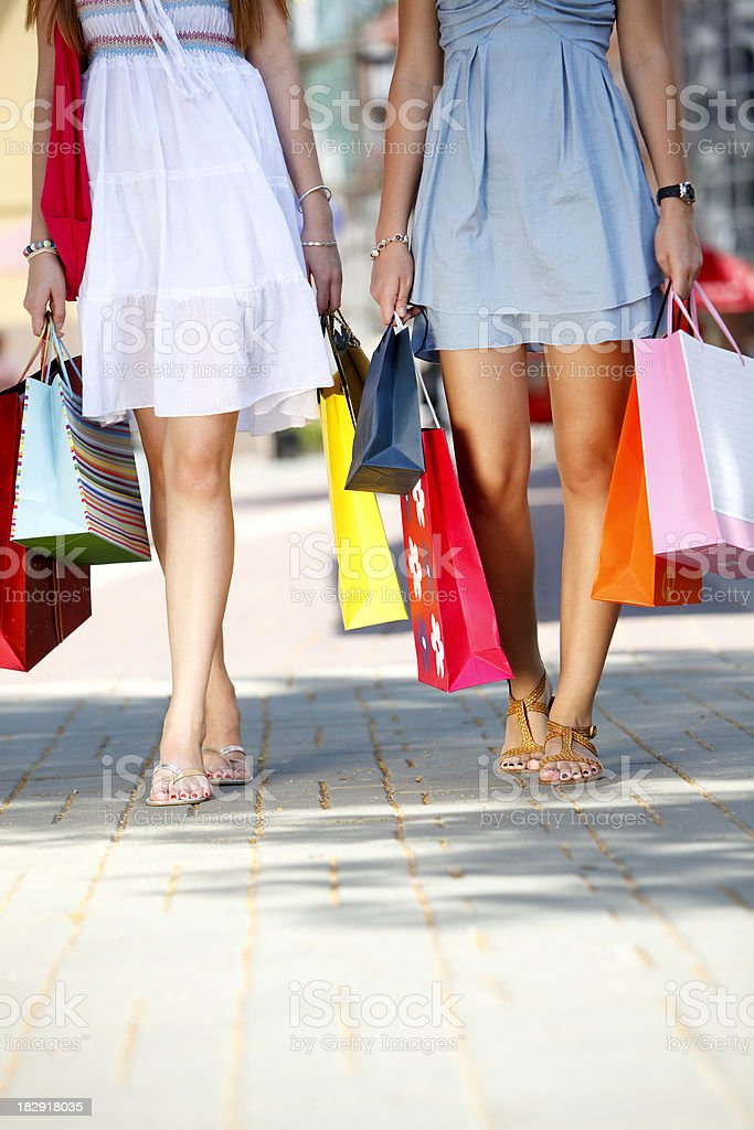 Low section of young friends carrying shopping bags royalty-free stock photo