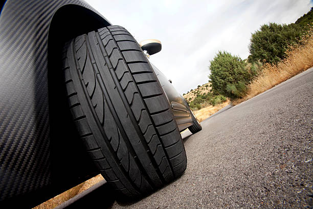 Low shot of a tire on a black car stock photo