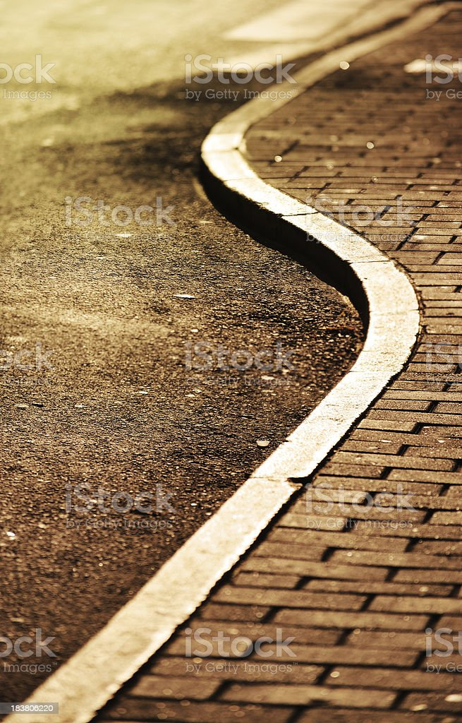 Low sun on curbstones in s shape royalty-free stock photo