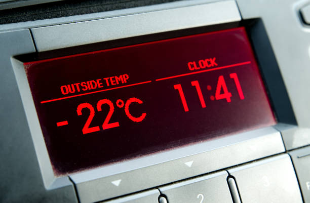 low temperature on car display .cold winter - mathe uhr stock-fotos und bilder