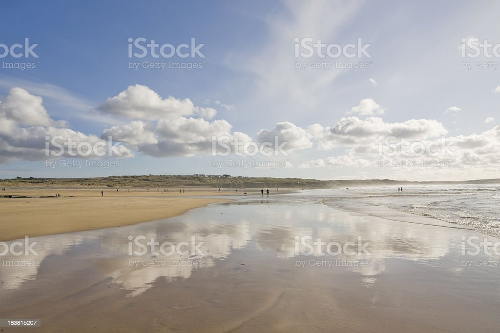 Low tide and fluffy clouds and Godrevy beach royalty-free stock photo