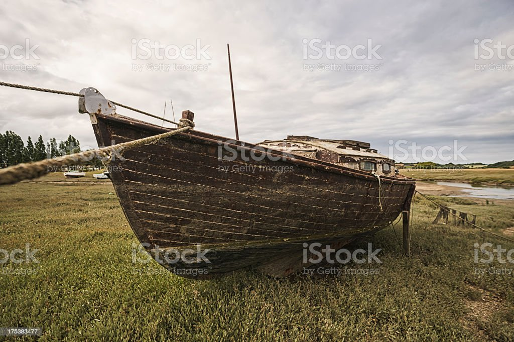 Low tide in Brittany with a stranded boat, France royalty-free stock photo