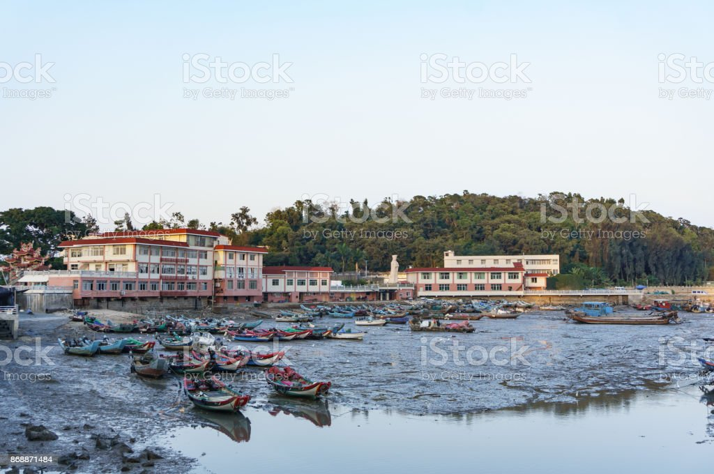 Low tide in harbour, boats be stranded stock photo