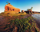 A dramatic landscape of sandstone cliffs, arches and islands shaped by the tides of the Minas Basin.