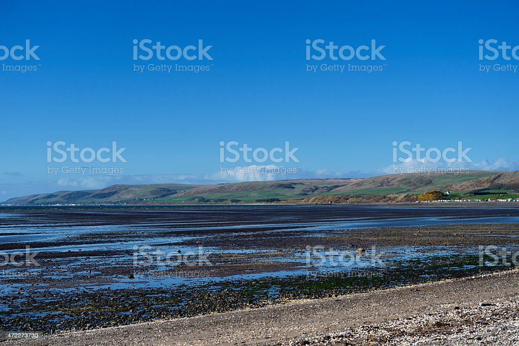 Low tide on a beach in south west Scotland stock photo