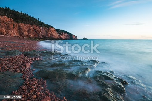 A long exposure of the eroded cliffs and rocky beach at low tide near Cape Chignecto, Nova Scotia.