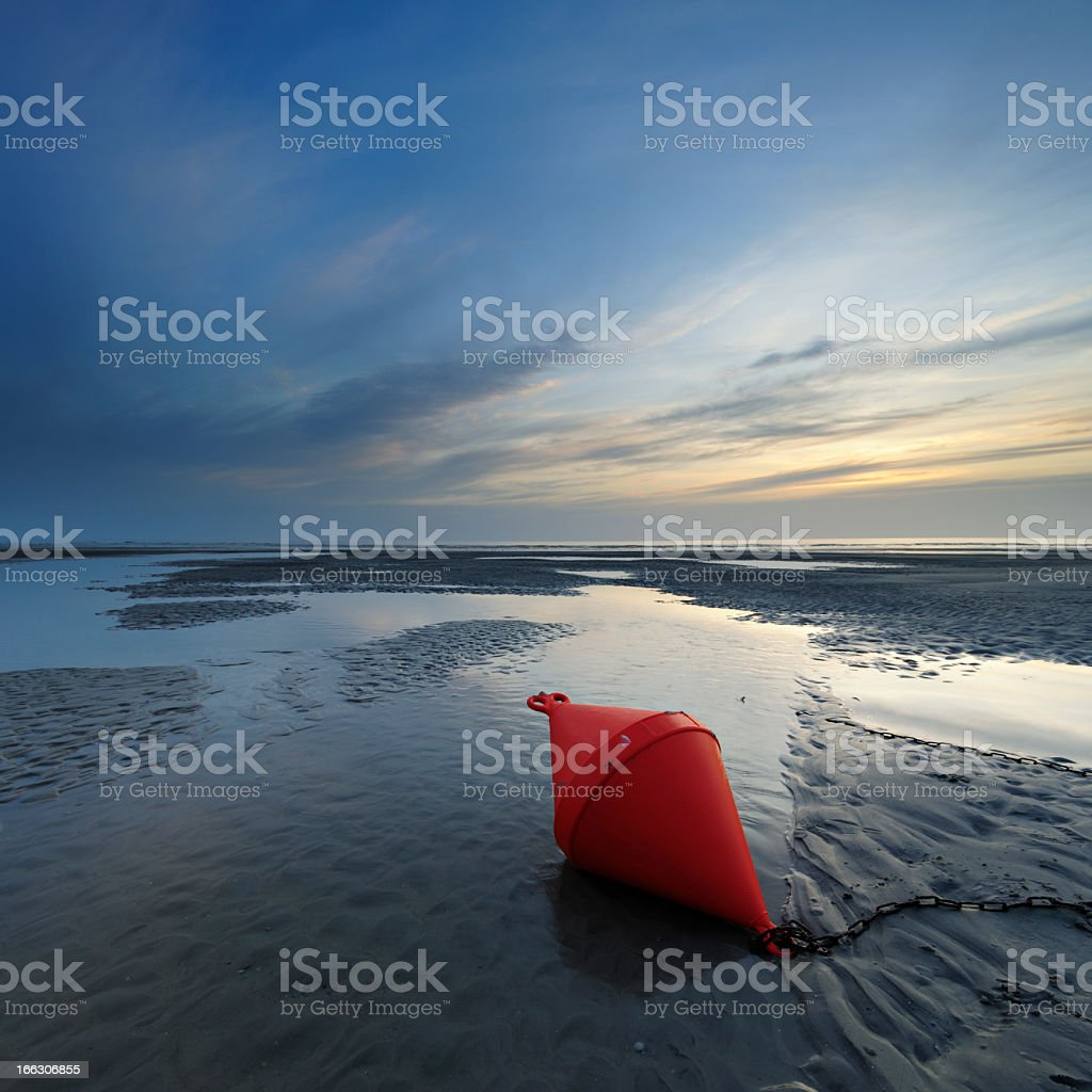 Low Tide Seascape with Buoy in Tidal Pool at Sunset stock photo