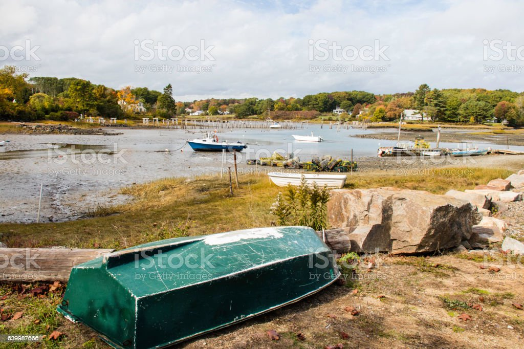Low tide with boats and Autumn color in Maine stock photo
