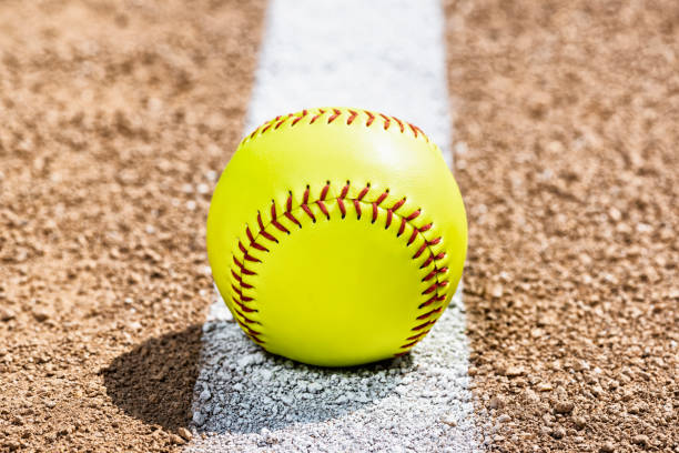 Low view of softball on Foul Line on dirt of softball diamond stock photo