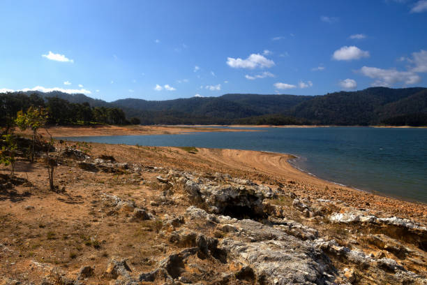 Low water during drought at Lake Tinaroo on the Atherton Tablelands in Queensland, Australia stock photo