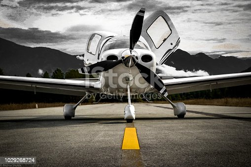 Low wing airplane on the ​taxiway in the mountainous region of British Columbia.