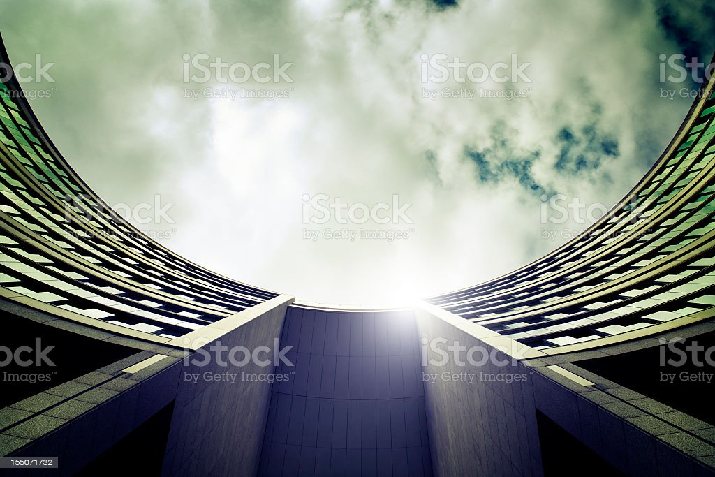 Low-angle view of a round office buildings atrium facade  Architectural Feature Stock Photo