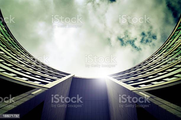 Lowangle View Of A Round Office Buildings Atrium Facade Stock Photo - Download Image Now
