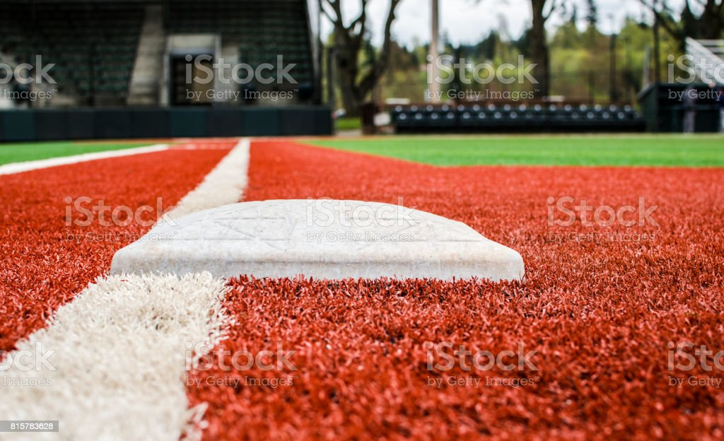Low-Angle View of First Base on Baseball Field stock photo