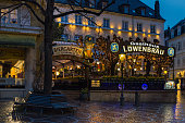 BADEN-BADEN, GERMANY - MARCH 30, 2018:  German Lowenbrau beer garden in Baden-Baden in the evening