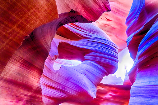 Lower Antelope Canyon in Page Arizona.  The canyon glows in colors of purple, reds and oranges. Shot a Canon 5D mark 3