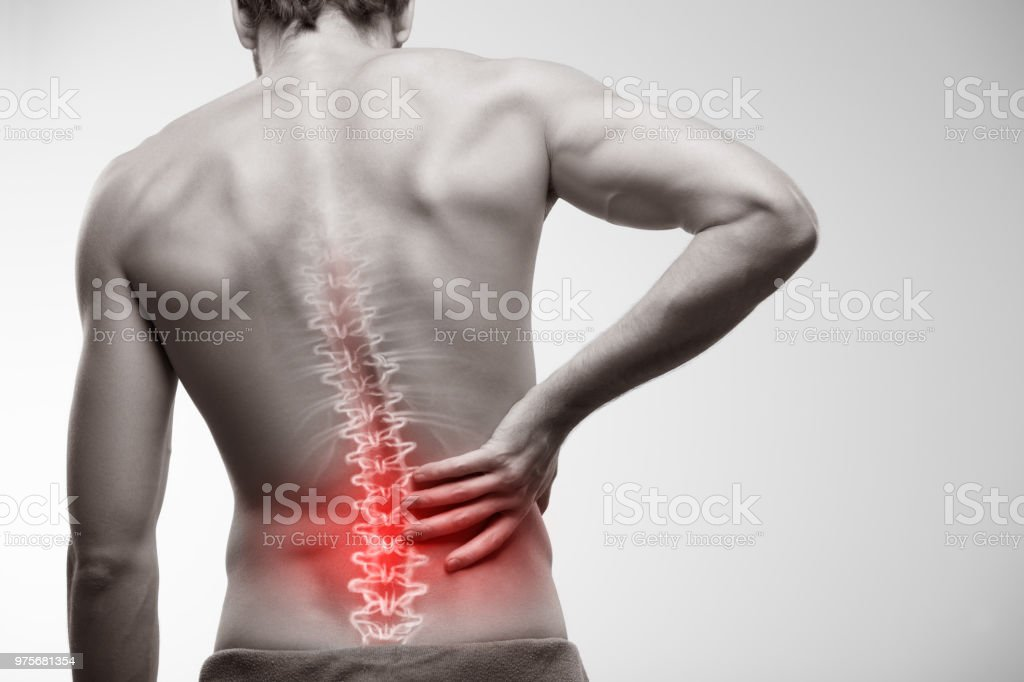 Lower back pain. stock photo