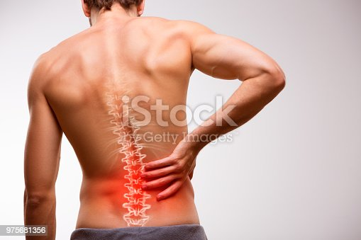 975681354 istock photo Lower back pain. 975681356