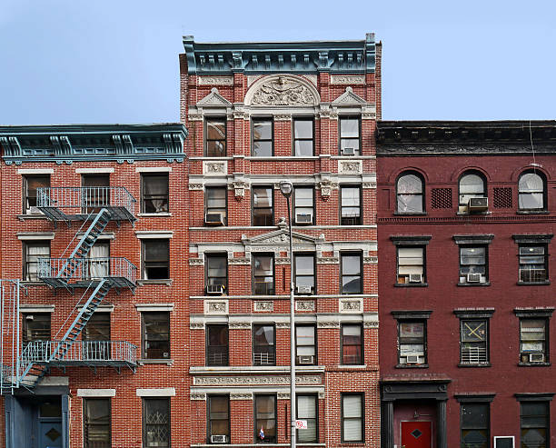 lower east side apartment buildings - lower east side manhattan stock pictures, royalty-free photos & images