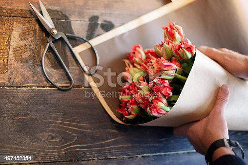 Аlower lays on the board. Professional florist men collecting flowers. Florist at work.