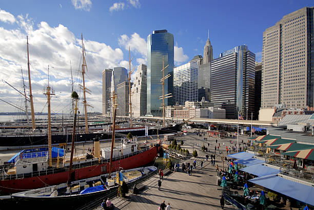 Lower Manhattan at South Street Seaport Manhattan skyline from the South Street Seaport. south street seaport stock pictures, royalty-free photos & images