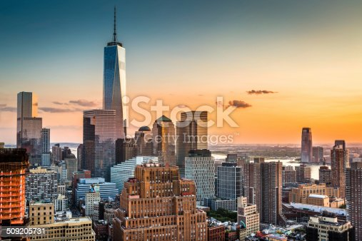 Lower Manhattan skyline at sunset with Freedom Tower standing tall above the skyline