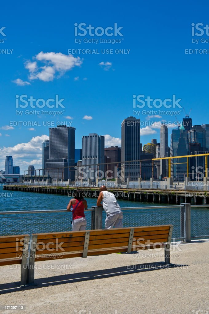 Lower Manhattan cityscape seen from Brooklyn Heights waterfront park, NYC royalty-free stock photo