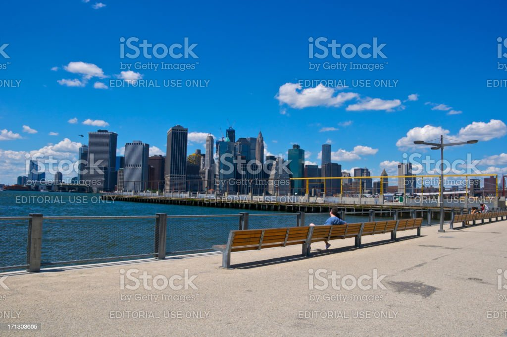 Lower Manhattan cityscape seen from Brooklyn Heights waterfront park, NYC stock photo