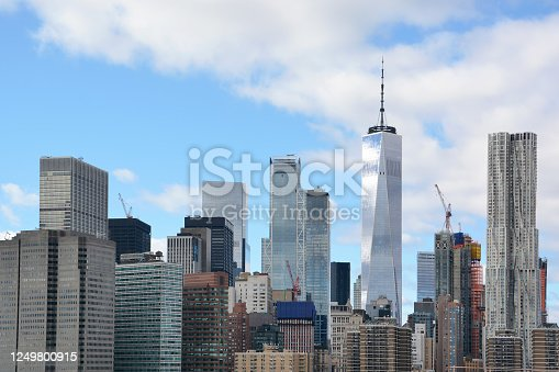 Low angle view of Manhattan taken from East River with skyscrapers, Freedom Tower and Financial District in New York City, USA