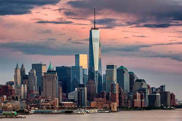 Lower Manhattan NYC from Weehawken NJ Lower Manhattan and One World Trade Center in New York City, USA around sunset. Captured from Weehawken, New Jersey. lower manhattan stock pictures, royalty-free photos & images