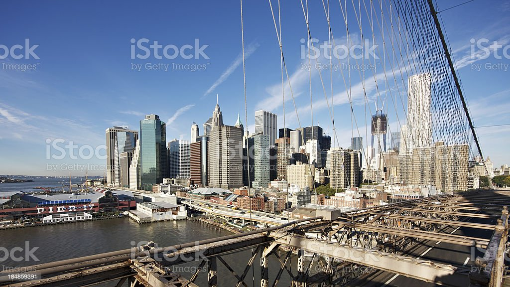 Lower Manhattan seen from Brooklyn bridge at sunrise stock photo