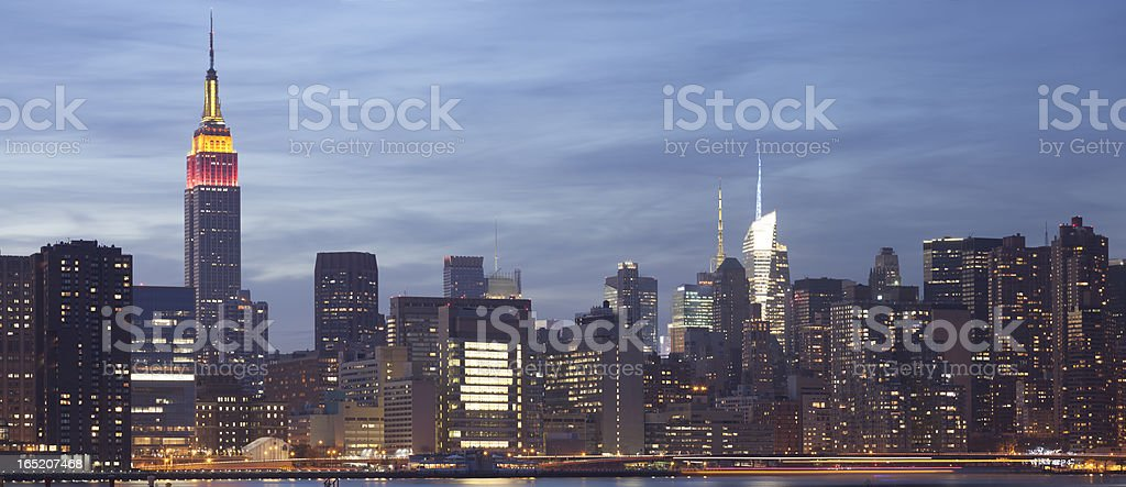 Lower Manhattan skyline at dusk panoramic stock photo