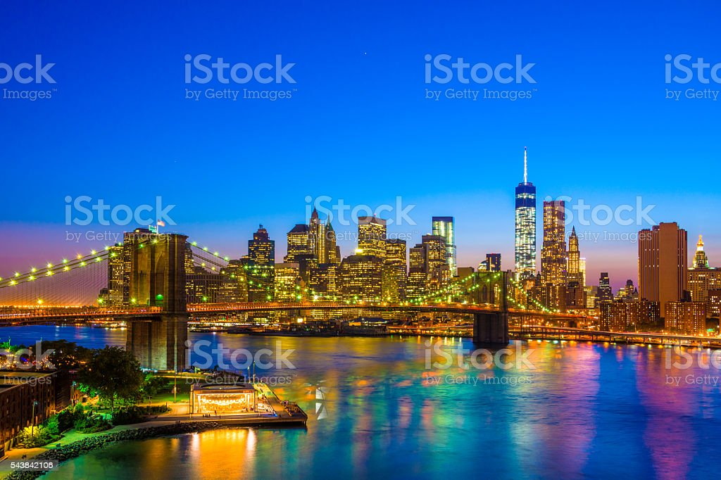 Lower Manhattan Skyline at Dusk with Brooklyn Bridge stock photo